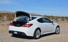 2013 Hyundai Genesis Coupe 2.0T. The trunk is fairly big, but the trunk opening isn't.