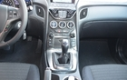 2013 Hyundai Genesis Coupé 2.0T. The centre vertical console is very user-friendly. It includes a closed compartment for the iPod and auxiliary device ports (look behind the gearshifter).
