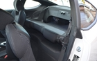2013 Hyundai Genesis Coupe 2.0T. The rear seat back folds down, but just in one piece, making the vehicle even less versatile.