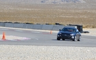 2013 Hyundai Genesis Coupe 3.8 GT. On the track, the suspension did a very good job keeping roll under control. That said, this V6 version is more comfortable on the highway.