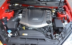 2013 Hyundai Genesis Coupe 3.8 GT. The 3.8L V6 with direct injection (GDI) delivers 348 horsepower and 295 lbs.-ft. of torque.