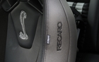 The Shelby's cobra insignia is embroidered on the excellent Recaro seats