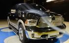 RAM 1500. Improved aerodynamics, quad headlamp design, vertical foglights (photo: Laramie)