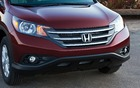 The CR-V's visual signature includes several interesting elements, such as the classic Honda front grille.