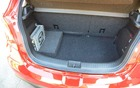 The Mazda2 EV's trunk is almost as big as the conventional version's.
