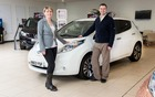 Dr. Brett Garner and his wife next to their Nissan LEAF