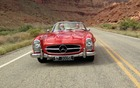 The 1957 Mercedes-Benz 300 SL Roadster in action with John Rich at the wheel and Rob Myers of RM Classic Cars as his co-pilot.